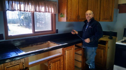 Art getting ready to remove his homemade counter top!