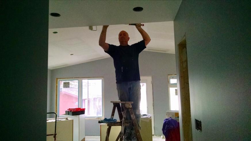 Art finishing up some livingroom paint